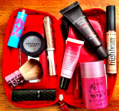 "When it comes to makeup, I'm very nosy.  When a woman pulls out a makeup bag from her purse, I need to see what's inside.  Not to critique, but to learn more about them, their style, and maybe get some new product suggestions.  Makeup is a great way to bond; it connects us more than we think. What's inside your makeup bag? Heather Rosenqvist San Antonio, TX Sugar mama, musical genius, bidness woman Maybelline baby lips lip balm in quenched , Sephora colorful mono shadow inChoco Excess 19 , Anastasia tinted brow gel,  Smashbox camera ready 5-in-one beauty balm spf 35, Benefit high beam highlighter, Too faced cosmetics flatbuki brush, NYX mood lip gloss, Revlon colorburst Lipstick in carnation, and Tarte dollface natural cheek stain. What products can you not live without? Anastasia Tinted Brow Gel.  After over- tweezing my eyebrows in the 90's, I'd feel naked without it! I've tried many brow products out there and its hands down the best one. Looks natural and lasts and lasts.  My favorite part is that once it's dry it really doesn't smudge. My other favorites are the Smashbox Camera Ready 5-in-1 Beauty balm. It's the perfect middle ground between tinted moisturizer and foundation; fantastic coverage with zero heaviness.  Last but not least is the Tarte Cheek Stain in Dollface.  It is perfect for my ""Snow White"" pale skin.  I've been a fan of their creamy blushes for years.   *If you would like to have your makeup bag featured, please contact me at liarliarlipsonfire@gmail.com"