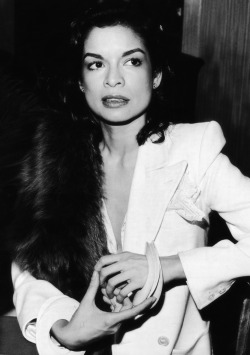 Bianca Jagger looking perfect in a crisp white suit.
