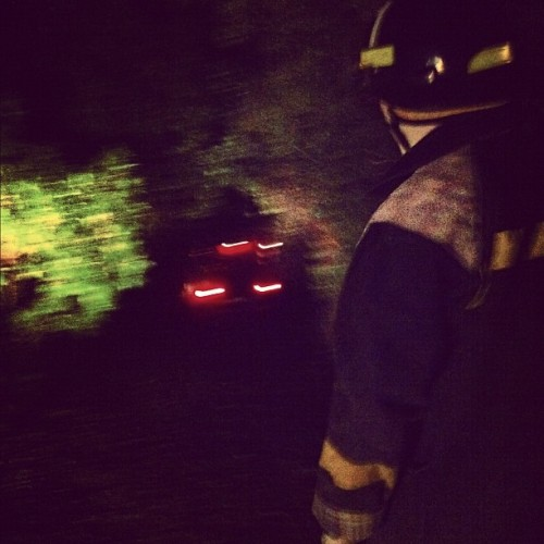 Firefighter making his way to the truck stuck in my mates driveway tonight as their deck and surrounding trees went up in flames. Made for an amazing sight but sure is scary reality to witness a flame of that size taking control  (Taken with instagram)