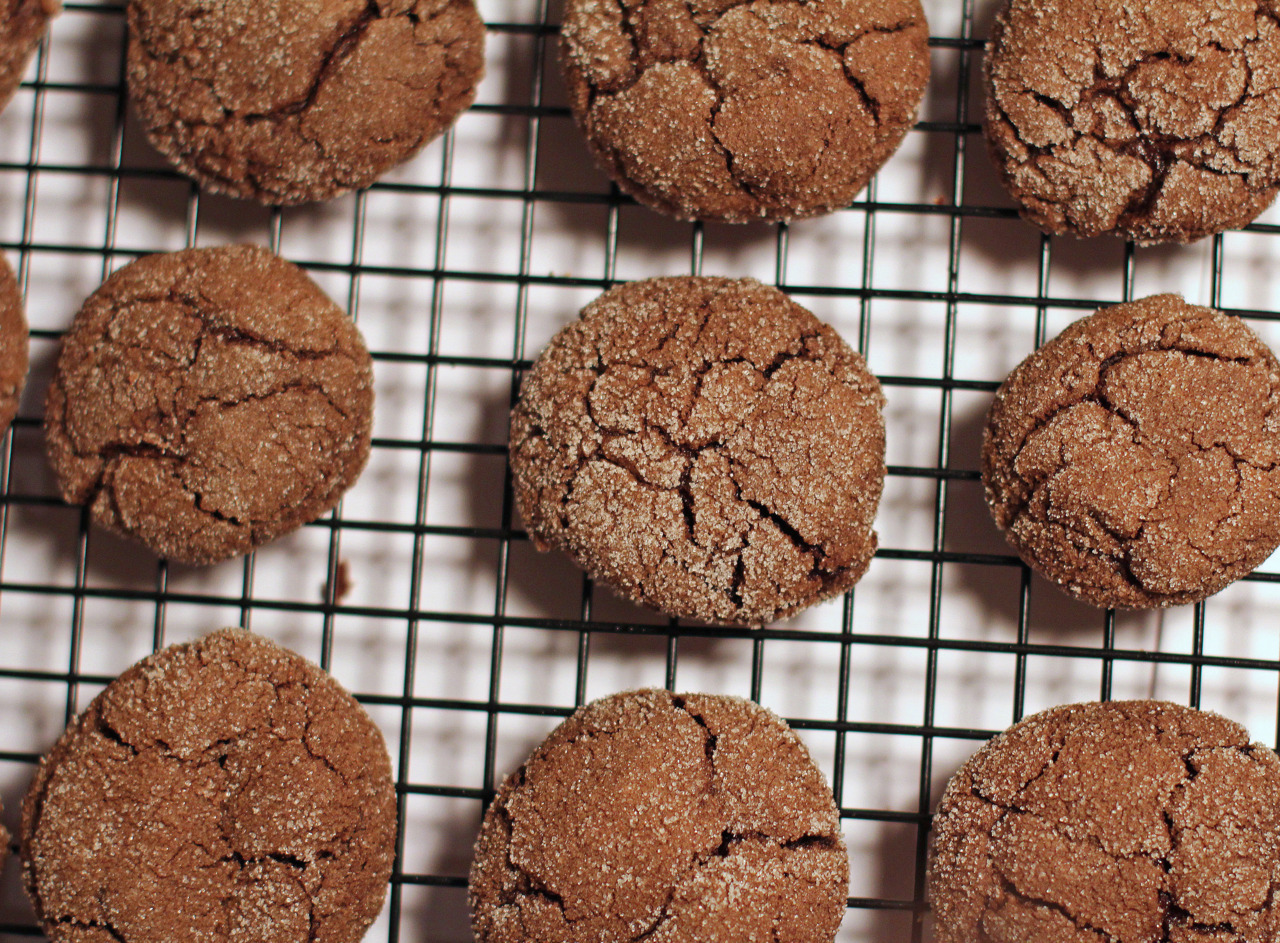 Healthy Mocha Crinkle Cookies AKA Cappuccino Crinkle Cookies  This is a healthy cookie recipe.  It is very coffee like, very chocolate like, and very light tasting.  The cookies come out puffy and looks hard, but when you go to pick it up, the cookie can be easily crumbled and you'll be surprised at how soft they are.  This recipe was on the Better Homes and Garden website.  They named them cappuccino crinkles, but since I had instant mocha on hand, they are now renamed Mocha Crinkle Cookies. The fun part about this recipe is dropping sticky heaping spoonfuls of dough into a bowl of sugar and coating them with sugar and then rolling them in between the palms of your hands and then coating them again in sugar so that they bake up nicely.  It seems like there is a lot of sugar in these cookies but when you go to eat one (one?? You'll probably end up eating three…four…five…okay I'm not going by experience……just saying..) you'll notice that they are not that sweet at all.  I was kind of hoping they would be sweeter but they are actually really tasty.  It's like eating coffee.. yes eating coffee… :) P.S.  These were two points each.. if you're doing Weight Watchers and you're curious.  Cappuccino Crinkles Recipe was from the Better Homes and Garden website. My notations are italicized. Ingredients 1/3 cup butter (no substitutes), softened (I used unsalted) 1 cup packed brown sugar (I used light brown, what I had in the pantry) 2/3 cup unsweetened cocoa powder 1 tablespoon instant coffee granules (I used a packet of instant Starbucks VIA Mocha) 1 teaspoon baking soda 1 teaspoon ground cinnamon 2 egg whites 1/3 cup vanilla yogurt 1 1/2 cups all-purpose flour 1/4 cup granulated sugar I wanted to put mini chocolate chips into the batter..but I forgot.  It would have went awesome with the whole mocha theme…but doh! my thinking failed me. =/ So if you make this recipe… try it with mini chocolate chips!  Directions 1.  Heat oven to 350 degrees F. 2.  Beat butter in a large mixing bowl with an electric mixer on medium to high speed for 30 seconds. Add the brown sugar, cocoa powder, coffee granules, baking soda, and cinnamon. Beat until combined, scraping sides of the bowl occasionally. Beat in egg whites and yogurt until combined. Beat in as much of the flour as you can with the mixer. Stir in remaining flour with a wooden spoon. 3. Place granulated sugar in a small bowl. Drop dough by heaping teaspoons into sugar and roll into balls between the palms of your hand (will be very sticky until you coat it with sugar). 4.  Roll again in sugar. Place balls 2 inches apart on an ungreased cookie sheet. 5.  Bake for 8 to 10 minutes or until edges are firm. Transfer cookies to wire racks and cool. Makes about 32 (I made about 38 from the batter).