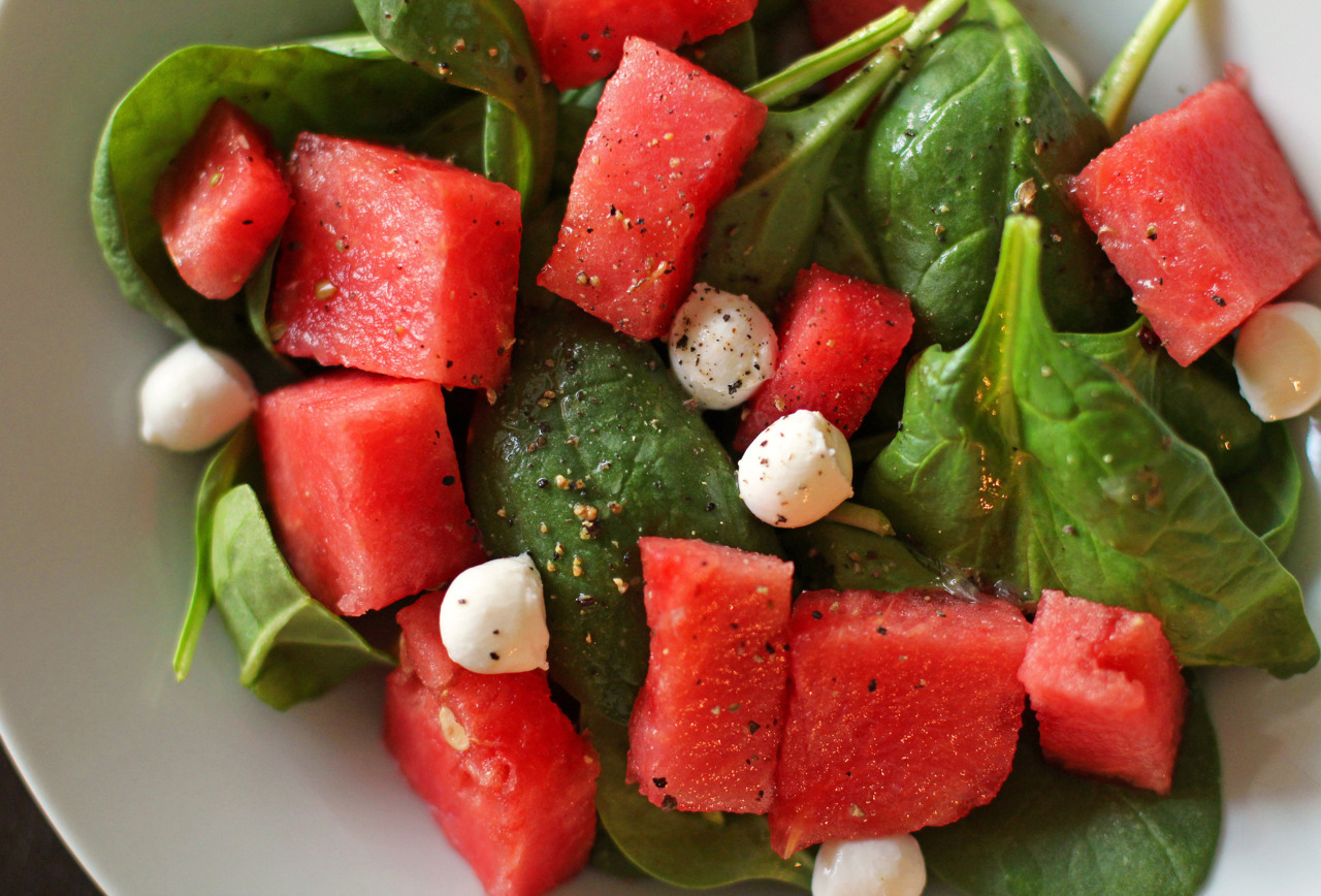 Spinach and Watermelon Salad What better way to pretend it's summertime than to eat watermelon?  Being that we've had such warm weather this winter, it's basically been spring since January.  So now it's time for summer and let's bring on the sun and hot weather already!  I love love love watermelon.  I love love love spinach.  I love love love cheese.  So let's put them together!  I wasn't too sure about mozzarella on this salad, I knew feta would go really well with it, but I really didn't want to buy a thing of feta and only use it for this one salad.  I could get more use out of mozzarella over a few courses than I would with feta.  So I got mozzarella.  And good thing it actually worked out really well.  I used a very light homemade dressing.  My go-to salad dressing actually.  I'm not really sure of the measurements, but I will guess for blogging purposes… ^_^ Honey Lime Dressing 1 tablespoon of honey 1/2 lemon or lime (I used a lime that was in my fridge) 1 tsp olive oil salt, to taste freshly ground pepper, to taste Mix the ingredients together.  Taste it and see how you like it and adjust accordingly if you want it a little sweeter or a little more tart.  This dressing complements the watermelon spinach combination really well.  This amount was enough to dress two salads, so adjust accordingly if you need more dressing.  Put your spinach, watermelon, mozzarella (or feta..if you really want) together and mix the dressing over it.  SO GOOD!  You must try!