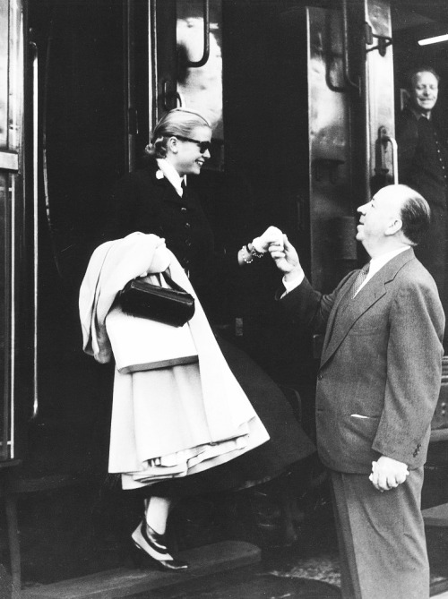 vintagesonia:  Alfred Hitchcock greets Grace Kelly, C.1950's
