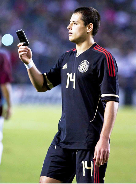 Fan throws a cellphone at Chicharito during a game