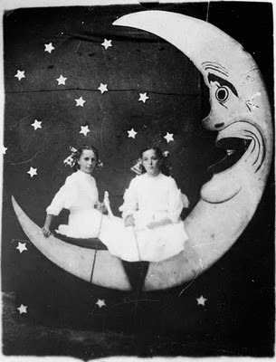 two girls on a wonderfully bizarre paper moon
