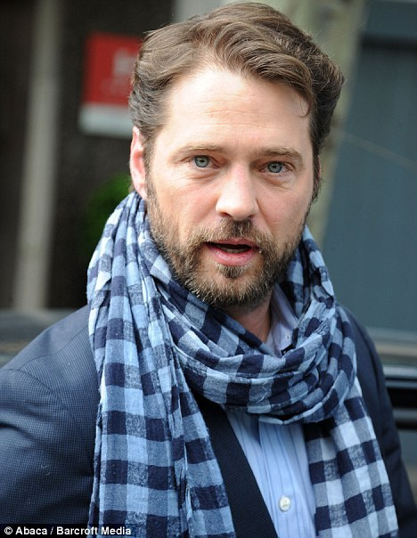 Celebrity Scarf Watch: Jason Priestley wearing a grey checked scarf in Paris, France.
