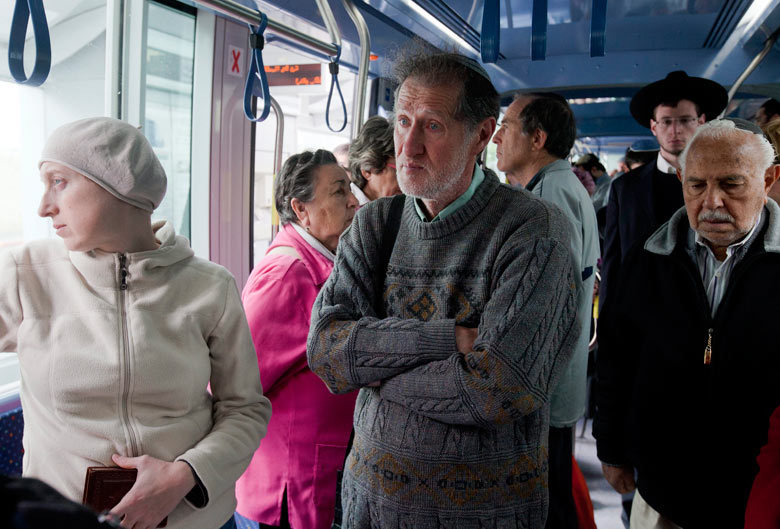 guardian:  Passengers on a tram in Jerusalem observe a two-minute silence for Yom HaShoah, when the nation remembers the 6 million Jews who died during the Holocaust Photograph: Jim Hollander/ EPA