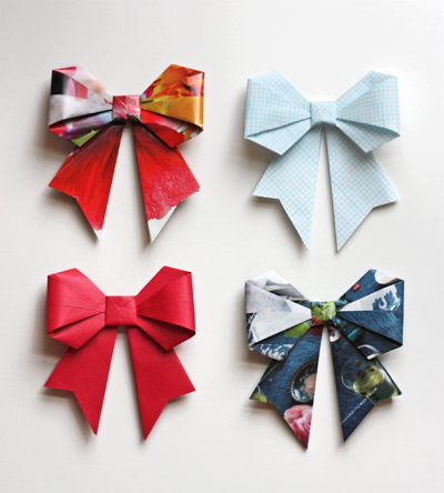 truebluemeandyou:  DIY Recycled Paper Origami Bows. Cute and easy project to dress up packages cheaply. Link at How About Orange here.