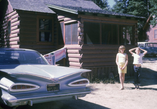 1950s  Two children in front of a cabin.