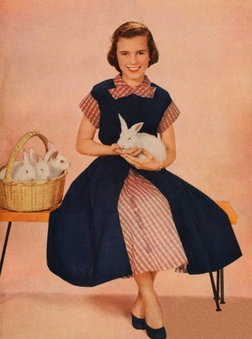Girl holding rabbit Magazine Cover, 1952.
