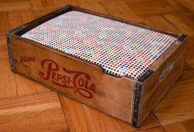 Soda crate = pet bed. Made by Tom Davie — check out Tom's site for other crate and fabric combinations. (Via Soda Crate Pet Bed @Craftzine.com blog.) More pet beds and animal houses made from repurposed materials can be found here.