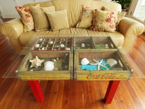 Soda crates = combination table / shadow box for displaying stuff. From DIY Network: To DIY, attach crates to an old table base, then add a piece of tempered glass on top.  In case you missed them, earlier Unconsumption posts on repurposed vintage soda crates: as pet beds, chairs, and vertical gardening containers. Find more crate repurposing here. (Spotted on Pinterest here.)