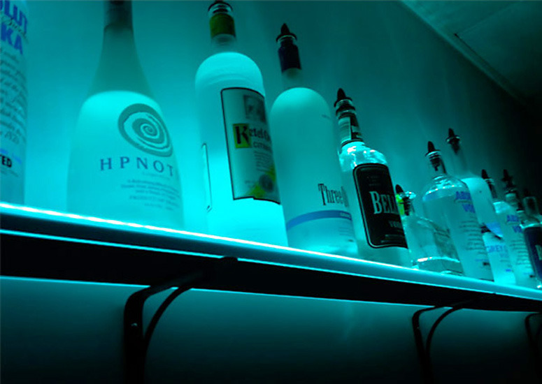 Illuminated liquor shelf - cool for alien or mad scientist themed parties