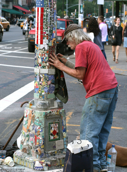 "Jim Power, The Mosaic Man St. Marks Place, NYCMore photos of Jim Power, The Mosaic Man's work.___________________________________________________  Voice of America's ""Jim Power's Mosaic Tiles Bring Art to New York Streets""  ___________________________________________________Jim - An East Village Story from Elvis Maynard on Vimeo.  ___________________________________________________MOSAIC TRAIL (1989) - Short video doc by filmmaker J Rosette from Camerado on Vimeo."