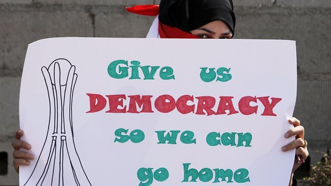 girlsandrevolts:  Pressure: Bahraini protestors rally outside U.S Embassy to put pressure on the Al Khalifa regime towards democratic reforms. Picture: Hasan Jamali  Read more: http://www.news.com.au/world/bahraini-protesters-target-us-embassy/story-fn6sb9br-1226017382974#ixzz1sbKt7AGC