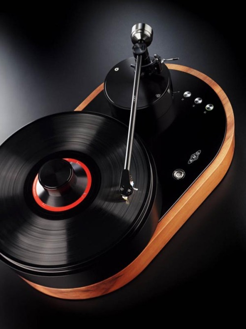 "weandthecolor:  Outstanding Product Design Stunning turntable design by AMG (Analog Manufaktur Germany), called Viella 12.  ""Precision engineering and classic design are embodied in the first turntable from AMG (Analog Manufaktur Germany), the Viella 12 or simply, V12. The AMG turntable line was created by a group of audio industry experts to advance the art of vinyl playback Werner Roeschlau, designer and driving force behind AMG, works with his son and other master machinists at their bespoke multi-story Bavarian factory located north of Munich. All machining is done in house, combining the latest Computer Aided Design and CNC machines with ""classic analog"" tools including custom lathes and drill presses. Their factory has been manufacturing key, precision parts for some of the world's most highly regarded turntables for over a decade. This expertise in the design and manufacture of turntables led to the AMG line, premiering with the Viella 12.""  via amg-turntables.com via: WE AND THE COLORFacebook // Twitter // Google+ // Pinterest"