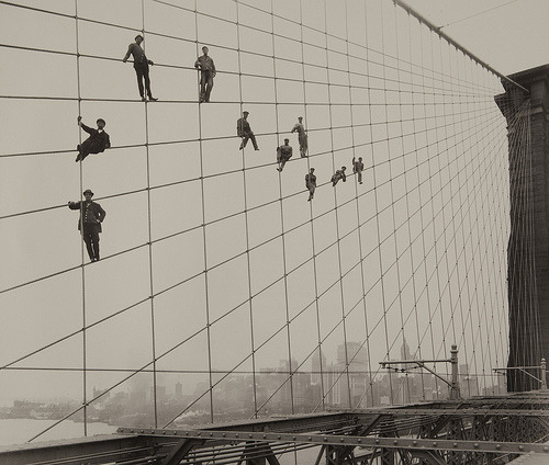 turnofthecentury:  Painters on the Brooklyn Bridge Suspender Cables-October 7, 1914 by Eugene de Salignac  from MoPA