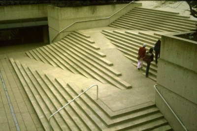 Love how these stairs incorporate a wheelchair access ramp. Smart or not ? - Location Robson Square · Vancouver, British Columbia