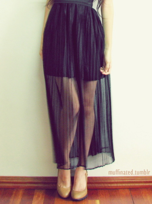 Veiled skirt over studded pumps.