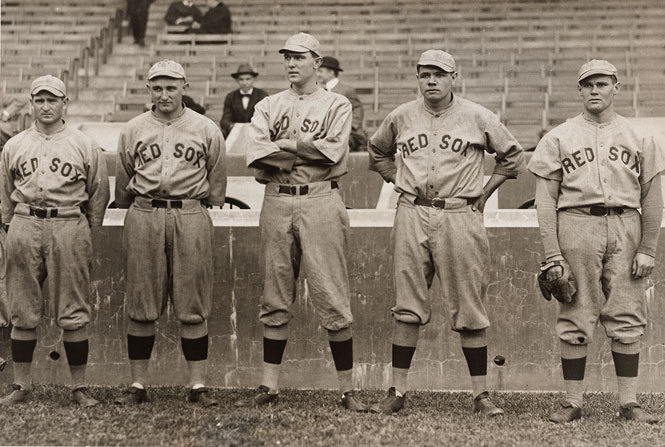 "Babe Ruth and Other Red Sox Pitchers, 1915 Baseball season is here. This week's Smithsonian Snapshot celebrates the 100th anniversary of Fenway Park, home of the Boston Red Sox, with this 1915 photograph of Babe Ruth and other Red Sox pitchers: George ""Rube"" Foster, Carl Mays, Ernie Shore and Hubert ""Dutch"" Leonard. On April 20, 1912, the home ballpark of the Boston Red Sox opened to the public in Boston. The Red Sox beat the New York Highlanders, renamed the New York Yankees in 1913, 7-6 in 11 innings. Newspaper coverage of the opening was overshadowed by continuing coverage of the Titanic sinking days earlier April 14, 1912. In 1914, the Red Sox acquired George Herman Ruth Jr., best known as ""Babe"" Ruth, as their all-star pitcher. This 1915 photo shows Ruth with the pitching staff that helped propel the Red Sox to a World Series Championship the same year. This photo marks Ruth's second season in the major leagues. In six seasons as a pitcher, the 24-year-old Ruth compiled an 89-46 won-lost record, with a 2.28 ERA and three World Series victories. Had he continued to pitch he would have ranked among baseball's greatest pitchers. This is a rare photograph of Ruth in the beginning of his career; it helps the Smithsonian fully describe the impact of this legendary baseball player. To view more sports-related items at the Smithsonian, visit the National Museum of American History's sports and leisure collection. This item is one of 137 million artifacts, works of art and specimens in the Smithsonian's collection. It is not on display. To learn more about this item, visit the National Portrait Gallery's website."