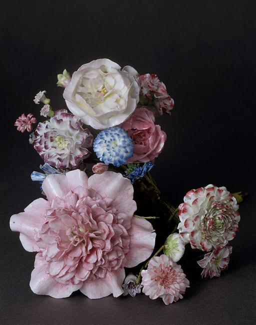Bouquets of porcelain flowers, Sevres porcelain manufacture, mid 18th century. Among the many beautiful and singular things that Madame de Pompadour liked to acquire and collect wore finely crafted porcelains,  which lead to her lifelong connection with the legendary Sevres porcelain manufacture which she helped establish and perfect by having the  Vincennes factory moved to Sevres, closer to Versailles and even closer to her Bellevue country house estate bought for her by the king.  In its early days Vincennes factory gained popularity by making perfumed porcelain flowers, painted to look as close to the real thing as possible, they were relatively easy to make and became an instant best seller, and Madame de Pompadour, with her deep love for flowers adored these and as the legend goes filled her gardens with them, intermixing with real blossoms, and inviting the King to view her beautiful gardens fooling and impressing him with its artistic realism.