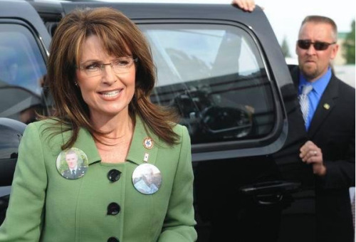 "Fired Secret Service agent's creepy photo of him checking out Sarah Palin's hot mama grizzly bod David Randall Chaney retired from the Secret Service yesterday amid allegations that he was among those who hired prostitutes in Cartagena last week. This isn't the first time he's engaged in questionable behavior. In 2009, he posted two pictures of himself with Palin taken during the 2008 presidential campaign, commenting, ""I was really checking her out, if you know what i mean?"" Via"