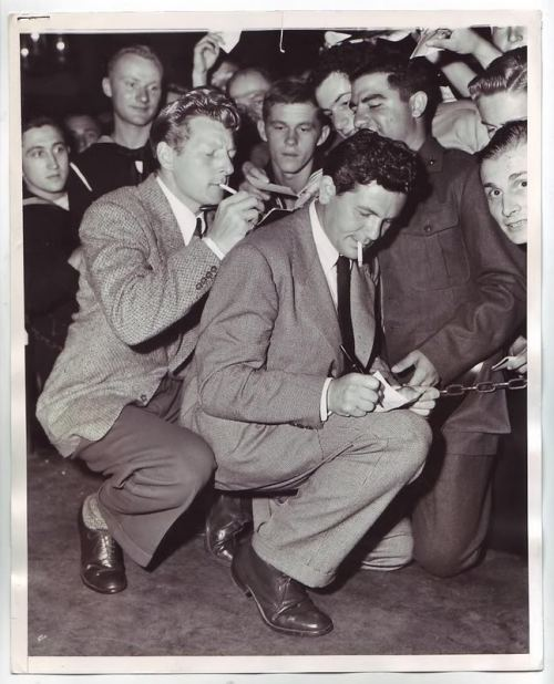 John Garfield and Danny Kaye sign autographs at The Hollywood Canteen.