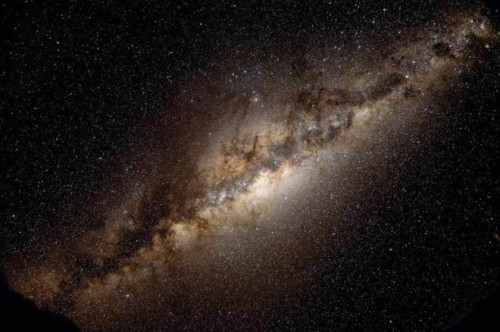 "ikenbot:  Has Our Galaxy's Dark Matter Gone Missing?  If a new study is true, then the search for dark matter just got a lot weirder. Our little corner of the Milky Way contains no observable concentration of the mysterious stuff whose gravity binds the galaxy, claims one team of astronomers.  That finding would present a major problem for models of how galaxies form and may undermine the whole notion of dark matter, the researchers claim. But some scientists doubt the reliability of the team's method for measuring the elusive substance.  ""This is not just some piddling little detail,"" says Frederic Hessman, an astronomer at the University of Göttingen in Germany who was not involved in the work. ""If this is right, it turns everything totally upside-down."" But that's a big if, says Julio Navarro, an astrophysicist at the University of Victoria in Canada: ""The argument is provocative, but it remains inconclusive, in my opinion.""  According to standard cosmology, we should be swimming in dark matter. Measurements of the afterglow of the big bang—the so-called cosmic microwave background—and of the distribution of the galaxies suggest that 85% of all matter in the universe is dark matter. What's more, decades of astronomical observations show that the stars within galaxies swirl about faster than they could if only the gravity of the others stars were holding them in. In fact, the speed with which the sun goes around the center of our galaxy suggests that dark matter ought to be about as abundant as ordinary matter at our distance from the galactic center, about 27,000 light-years.  But that's not what Christian Moni Bidin, an astronomer at the University of Concepción in Chile, and colleagues find. Using data gathered with several telescopes, they studied old stars called red giants in a cylindrical region a couple of light-years wide and extending 13,000 light-years above the plane of the galaxy.  Treating the stars a bit like atoms in a gas, researchers assumed that they were trapped in the gravitational ""well"" of the galaxy. So by studying distributions of the stars' speeds in three dimensions, they could deduce the well's shape and hence the total distribution of mass from both dark and ordinary matter along the cylinder. Subtracting the distribution of ordinary matter as determined from star counts would then reveal the distribution of dark matter.  Continue.."