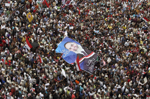 "Tahrir rally calls for end to military rule Thousands gather in Cairo calling for quick exit by military rulers and that ex-Mubarak officials be barred from poll. Thousands of people have taken to Cairo's Tahrir Square to protest against the handling of the nation's transition period by the ruling military council following the fall of former president Hosni Mubarak. Friday's demonstrators called for a quick exit of the Supreme Council of Armed Forces (SCAF) and that officials from the ousted president's government be barred from May's upcoming presidential election. Protesters gathered in the square chanted, ""down with military rule"", referring to the military's leadership role since the fall of Mubarak following protests in February of last year. Supporters of presidential candidates who were barred from standing earlier this month accused the generals of ""hijacking"" last spring's revolution. The crowds, growing throughout the day, have called for the military to hand over power to civilians. 'One hand' Al Jazeera's Mike Hanna, reporting from Tahrir Square, said Friday's rally was the most inclusive of recent demonstrations in the square. ""There are more than 20 political parties and political groups represented here"" he said. Following calls for unity among the gatherers, protesters began chanting ""one hand, one hand, one hand"". The chant is a modified version of one made famous during the February uprising when millions gathered throughout the country chanting ""the army and the people are one hand"". However, our correspondent said that despite the brief moments of unity during prayers, separate areas have been established for the various political factions gathered. Pictured: Thousands rallied in Tahrir, calling on the military to hand over power to civilians [Reuters]"