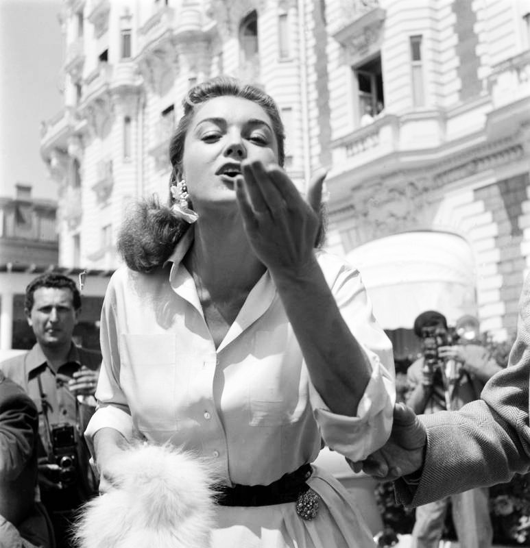 vintagesonia:  Esther Williams blows kisses to reporters at Cannes Film Festival. April 27, 1955