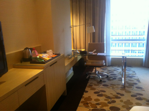 "Hotel, Shanghai, China. Exec level, in Puxi, Shanghai, China. If by some random freak chance, my writing ( or for that matter, my goldsmithing) causes some epic stir, I'll retreat where its quiet. Here. Overlooking the city, in golden orangey tones and pretty art and a nice glass desk. Some of book one WAS written here.  And they have the BEST exec lounge and buffet. Oh my word. But tonight its Toronto, with the dog giving a squeakytoy a working over.  ** Someone compared some of my work to the latest ""50 shades"" and another writer I'm reading got hit with that stick too. Dude. Yeah. Keep writing. We're better than that, I think. I kind of made an ""yeeearrgg!"" noise, much to the amusement of some. Ah well. You want the good brain tweak? Ask me for links. I'll hook you up with the good stuff, your brain's worth so much more."