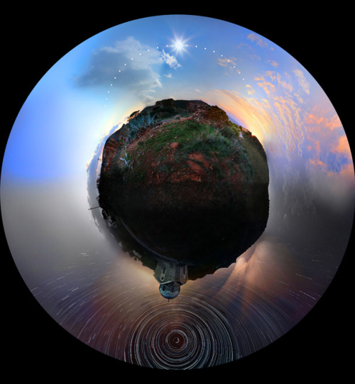 kari-shma:  24 Hours of Photographs Merged into a Single Panoramic Image  This amazing panoramic photograph (known as a stereographic projection) was recently captured by Greek photographer Chris Kotsiopoloulos during a mammoth 30-hour photo shoot in Sounio, Greece. The image is comprised of hundreds of photographs shot from daytime to nighttime that have been digitally stitched together to represent an entire rotation of the Earth (via: colossal)
