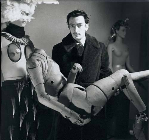 Salvador Dali and his mannequin, Surrealist Exhibition, Paris 1938