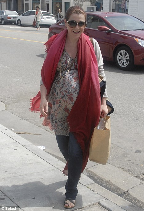 Celebrity Scarf Watch: Alyson Hannigan wearing a beautiful loosely draped pink shawl.