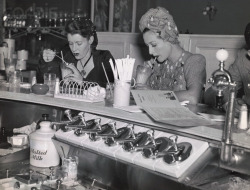 Joan Crawford at Soda Fountain with Editor Alice Thompson, 1939.