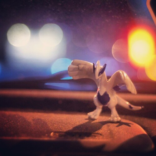 I love pokemon #lugia #pokemon #car #toy #photography #photoaday #night #streetlight  (Taken with instagram)