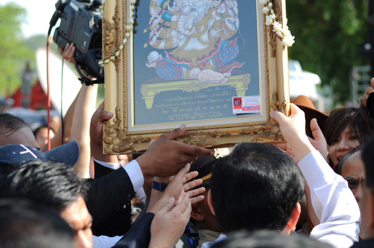 Fugitive former Thai Prime Minister Thaksin Shinawatra receives a gift from one of his supporters in Siem Reap, Cambodia.