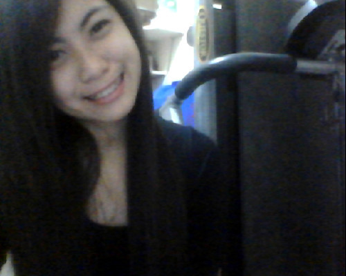 Wearing black so my fats won't be seen. Hi. I just feel like taking a webcam shot. Say hi to Mr. Treadmill.
