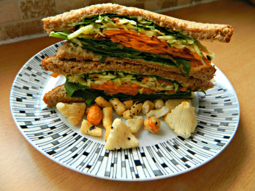 seedsnsmiles:  Lunch today was a beast of a sandwich - toasted wholemeal bread with lemon and coriander hummus, spinach, zucchini and carrot. Oh, and a few Japanese rice crackers. You look like a fool trying to get your mouth around it, but it's worth it.