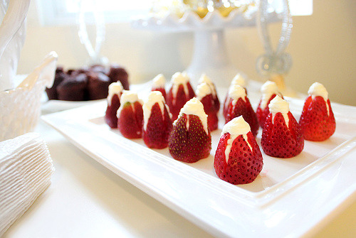 find-fitness:  Stuffed Cheesecake Strawberries These Strawberry Cheesecake Bites are simple and so, SO good! A low fat cheesecake filling is stuffed inside of hollowed out strawberries and then dipped into graham cracker crumbs. All the flavor of strawberry cheesecake and just a fraction of the calories. Perfect to fill in that sweet tooth at any time.Ingredients:  4 oz of low-fat cream cheese, softened 3 tablespoons of powdered sugar (depends on how sweet you want the filling) 1 teaspoon of vanilla extract 10-20 strawberries ( quantity is your choice ) 1/4 cup of graham crackers crumbs Instructions:Rinse strawberries and cut around the top of the strawberry. Remove the top and clean out inside with a paring knife if necessary. I found most of the strawberries already had a nice hollow center so that step was not necessary. If you want to stand your strawberries upright ( like in the picture ) slice a bit off the bottom. Combine cream cheese, powdered sugar and vanilla with a mixer or by hand. Add cream cheese mix to piping bag ( you can use a Ziploc bag ) and fill strawberries. Once strawberries are filled dip the top in graham cracker crumbs. Devour and fall in love. Enjoy! You could also drizzle or dip strawberries in chocolate if desired.