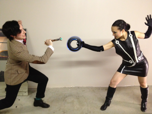 winzler:  d20burlesque:  Dr. Who versus Tron, backstage at the D20 Philly show, 2012. Lewd Alfred Douglas and Stella Chuuu  Eleven vs Quorra? Intriguing!  So I've been staring at this for the last five minutes, coming up with all the things Eleven could possibly have done or said to piss Quorra off. Meanwhile, Amy is off hitting on/getting hit on by Castor at the End of Line and Rory is trying desperately not to be killed by Rinzler.