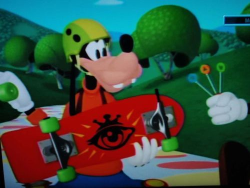 Goofy with the all-seeing eye on his skateboard…