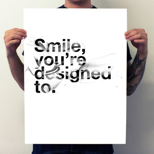 """explore-blog:  """"Smile, you're designed to.""""A beautiful reminder in smoketype fromartist and designer Dan Gordon."""