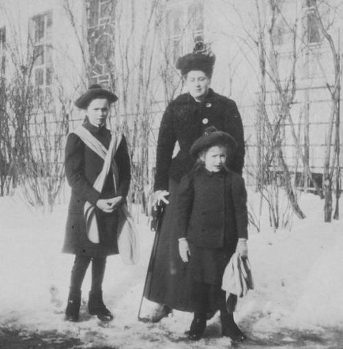 EDIT: Olga and Anastasia in the winter with Anna Vyrubova, who was the Tsarina's best friend and lady-in-waiting. (Thanks themauveroom)