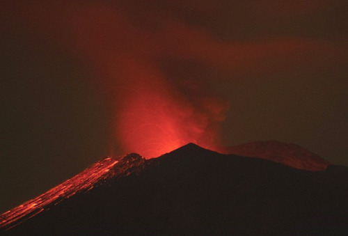 "Ready to Blow? Mexico Volcano Rumbles Mexico's Popocatepetl volcano has rumbled continuously and spewed gases and glowing rocks to almost one mile (one kilometer) beyond its crater, authorities said Friday. Popocatepetl is located about 34 miles (55 kilometers) east of the capital, Mexico City. More than 30 million people live within sight of the volcano. In an increase of activity the volcano registered ""62 expulsions of medium intensity, with the emission of water vapor, gas, ashes and glowing rocks,"" between Thursday night and Friday, said a statement from the National Center of Disaster Prevention. keep reading"