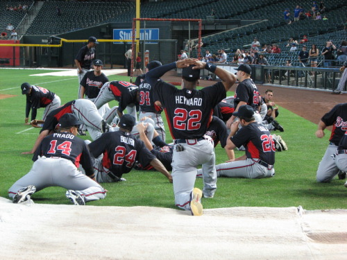 atlantabraves:  The Braves warming up before tonight's game.  Let's do it again Bravos!
