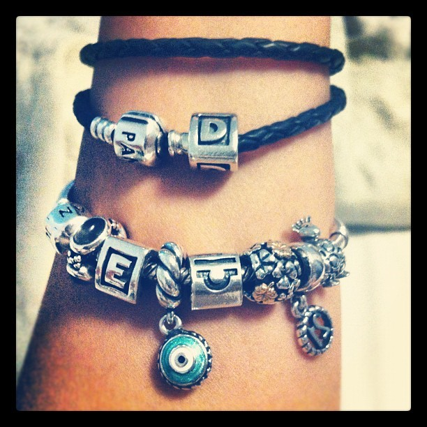 My #Pandora's. #silver #gold #enamel #charms #black #leather #clover #evileye #giraffe #moonstone #21 #libra #initials  (Taken with instagram)