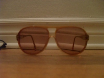 brown/rust aviator sunglasses, brown lenses, plastic frames and lenses, lightweight, 7$