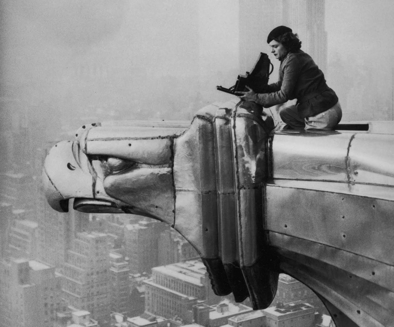 suicideblonde:  This photo of Life Magazine's photojournalist Margaret Bourke-White atop a steel gargoyle protruding from the 61st story of the Chrysler Building was taken by her dark room assistant Oscar Graubner in 1934.