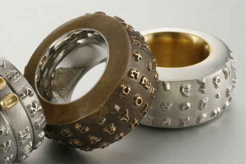 Rings made from old typewriter's typeball. Knowing how big these typeballs were, I wonder if this ring is a recreation of one OR the real, repurposed product. Needless to say, this ring is rather amazing.