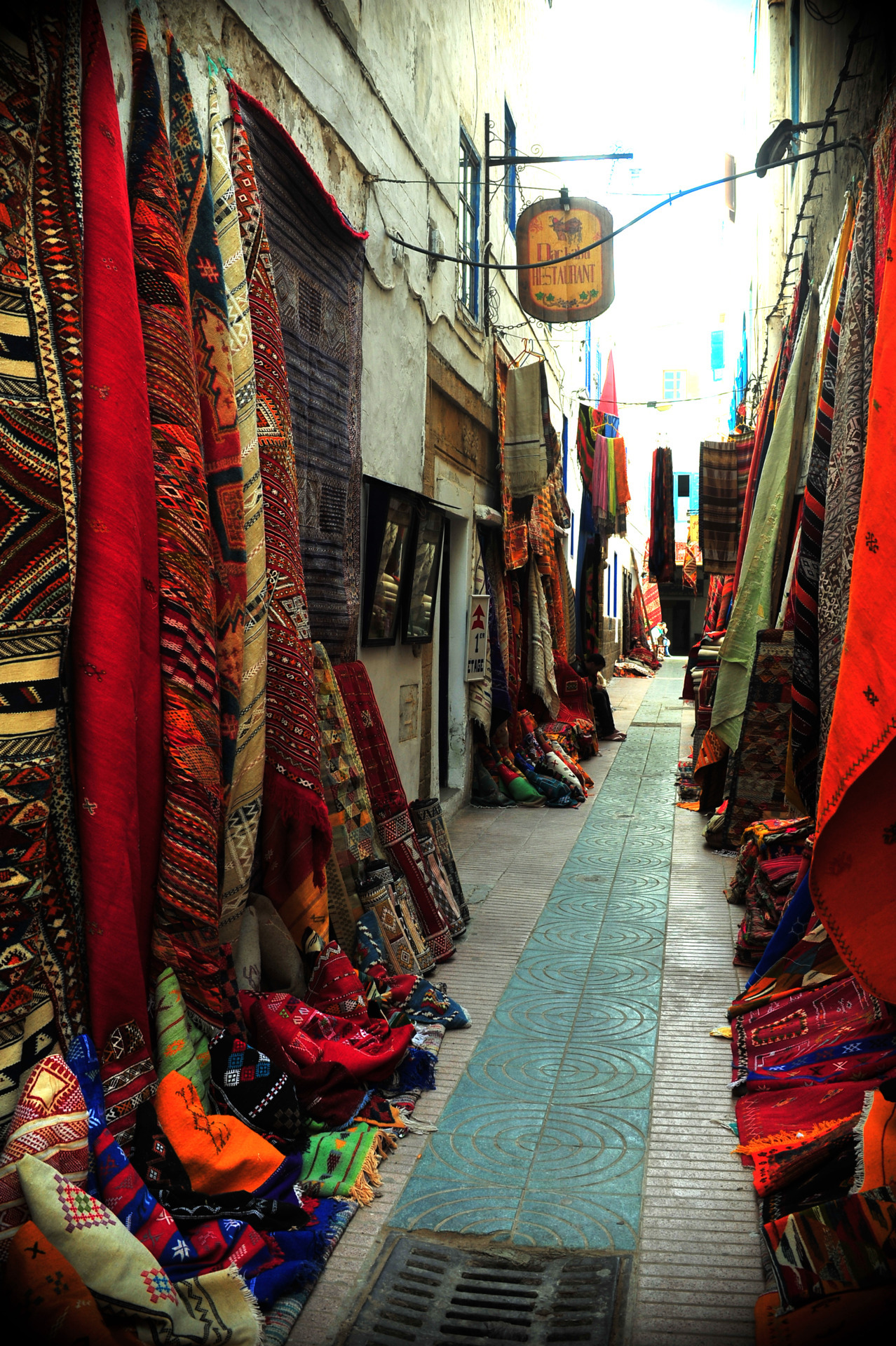 dynamicafrica:  Carpets line a narrow pathway in Essaouira, #Morroco image via svitoj